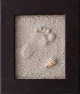baby footprint in sand