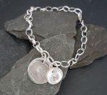 Fingerprint charm and initial bracelet